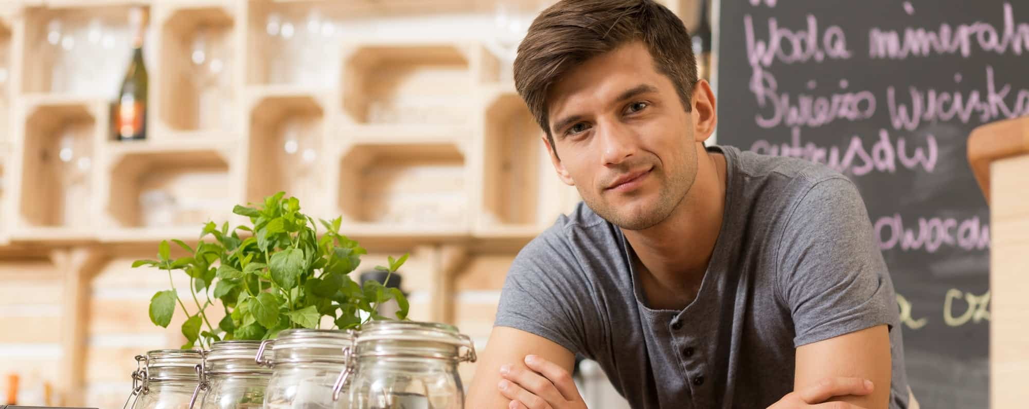 Young man working in restaurant